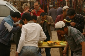 Melon stall, observed by tourists